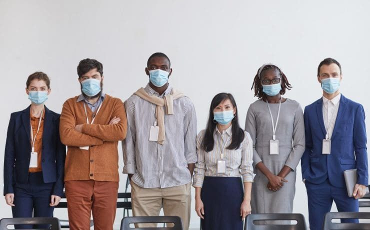 Team of Business People Wearing Masks